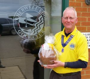 Lion President Phil with an Easter Egg, raffled by Cherwell Edge Golf Club