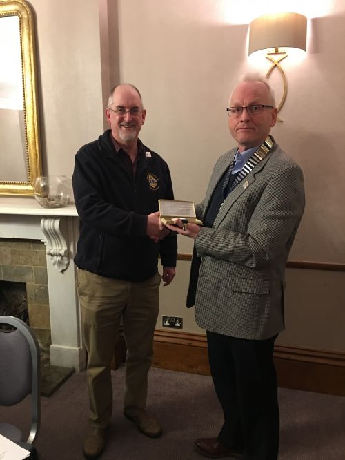 Lion President Phil Hassell (right) presenting Lion Ian Wilson with the Peter Taylor braces, for outstanding local efforts in organising our Children in Need event
